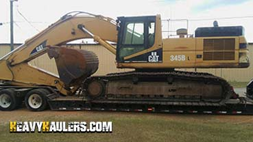 Caterpillar 345B Excavator In Transport