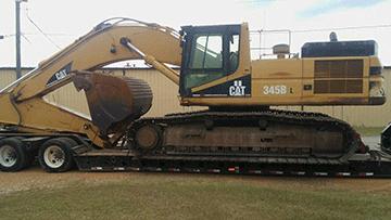 Hauling Caterpillar 345B Hydraulic Excavator