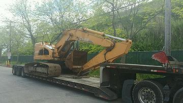 Transporting a Case CX240B Hydraulic Excavator