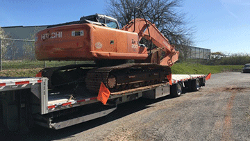 Hauling a Hitachi EX200 LC Medium Excavator