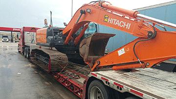 Transporting a Hitachi EX210LC Hydraulic Excavator
