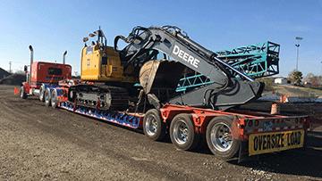 Transporting a John Deere 245G LC Excavator