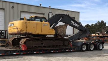Transporting a John Deere 270DLC Hydraulic Excavator