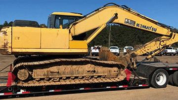Hauling Komatsu PC 200LC Hydraulic Excavator
