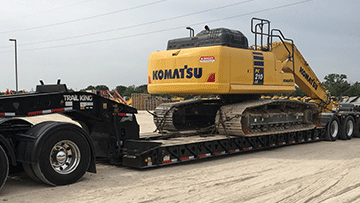 Hauling Komatsu PC210LC Hydraulic Excavator