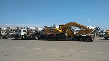 Hauling Komatsu PC 300-6 Hydraulic Excavator