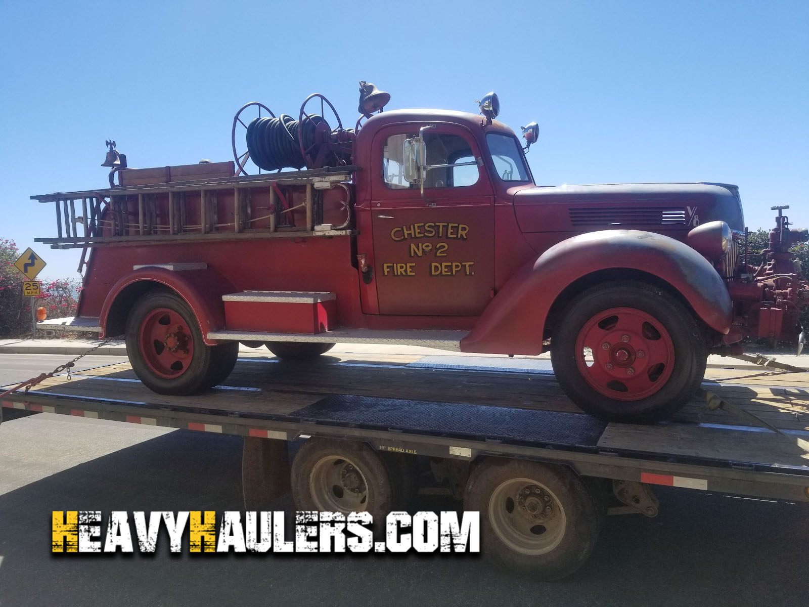 Antique 1940 Ford fire truck being transported