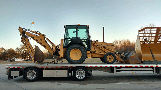 Transporting a Ford 655D Backhoe