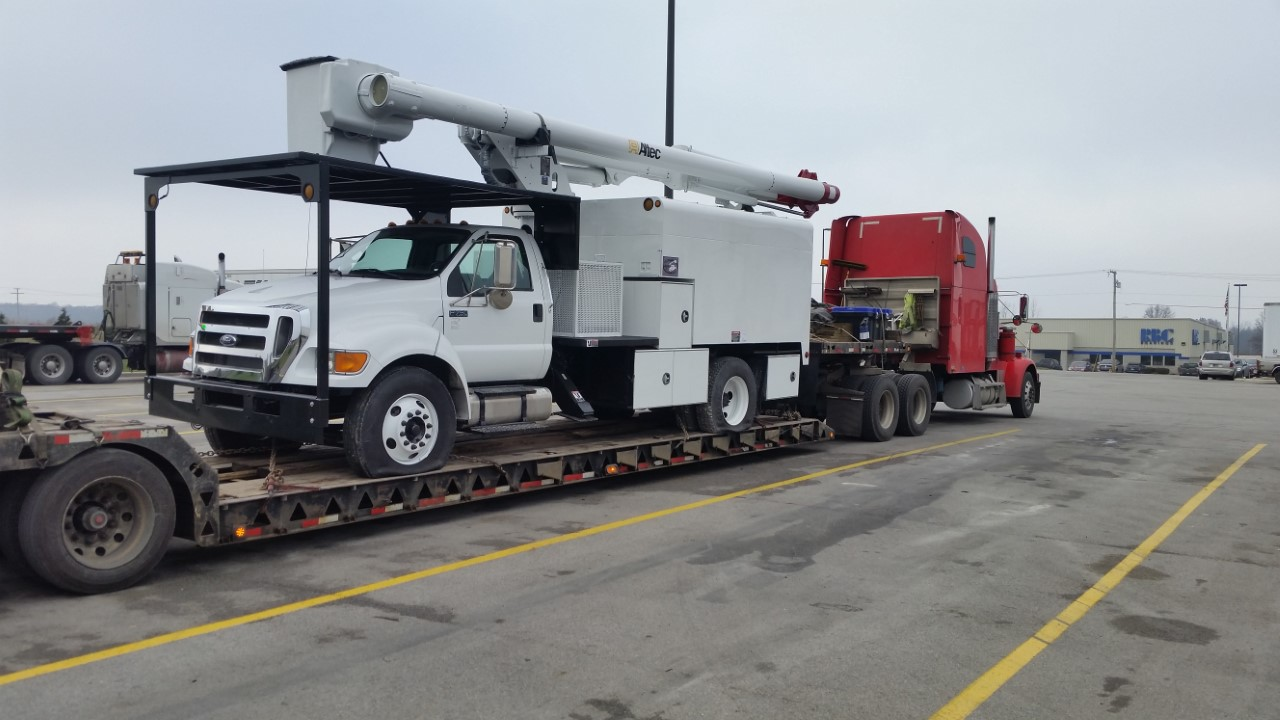 Ford Heavy-Duty Truck coming in hot on an RGN trailer