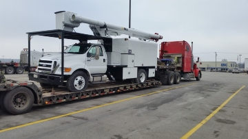 Ford F-750 Bucket Truck Hauled on an RGN Trailer
