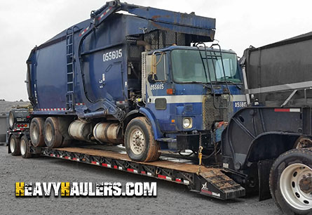 Shipping a garbage truck on an RGN trailer