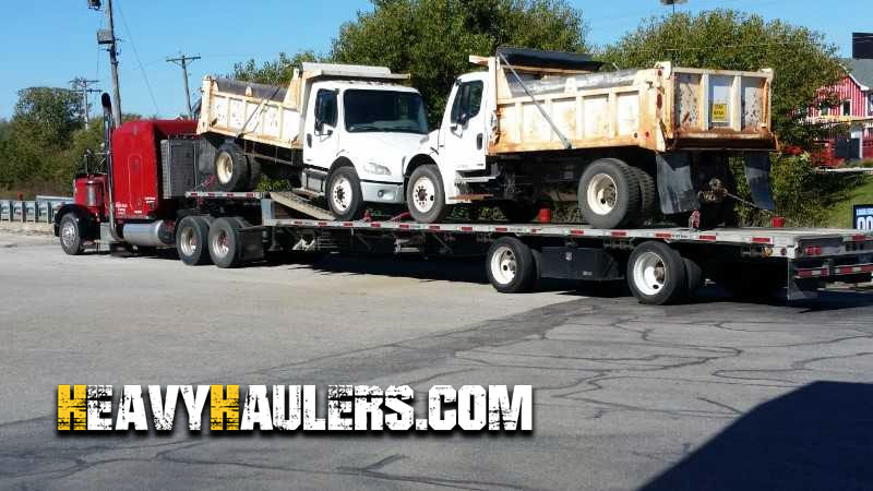 Transporting Two Single Axle Garbage Trucks