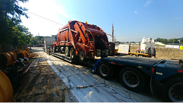 International Garbage Truck Transported on an RGN Trailer