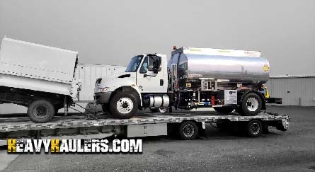 2019 International 4300 fuel truck on a flatbed trailer