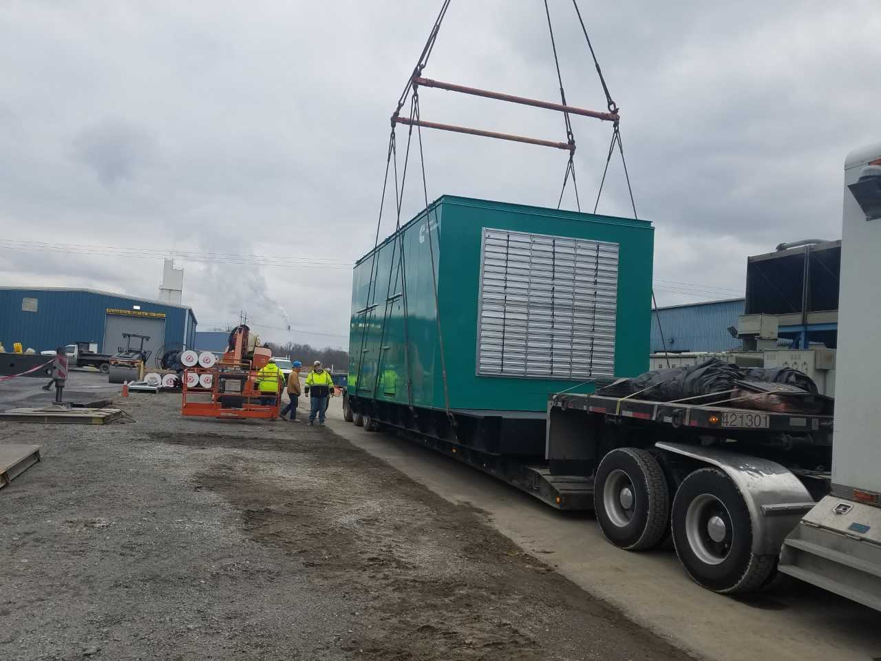 loading a large heavy generator with crane