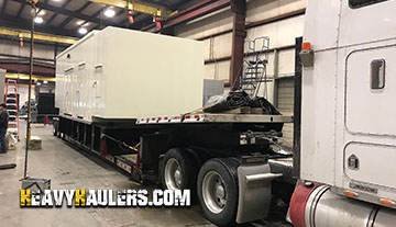 Backup generator being loaded onto a trailer