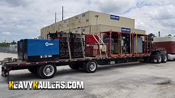 Transporting a Miller standby generator on stepdeck trailer