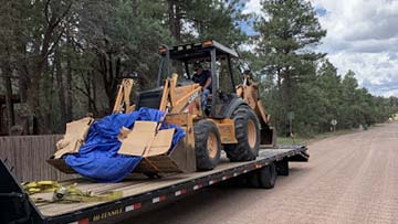 Case 590 backhoe shipped on a hotshot trailer