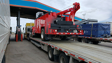 Kenworth T370 service truck shipped on a stepdeck trailer
