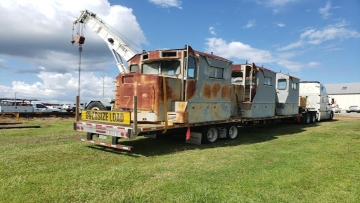 Vintage Locomotive Cabs hauled on a stepdeck trailer from GA to SC