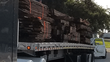 Hauling Lumber on a Flatbed to its Job Site