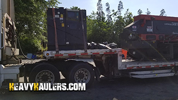 A turret press being hauled by Heavy Haulers