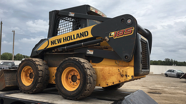 New Holland Skid Steer being Hauled