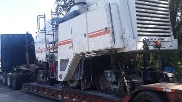 Komatsu wheel loader shipped on a flatbed trailer