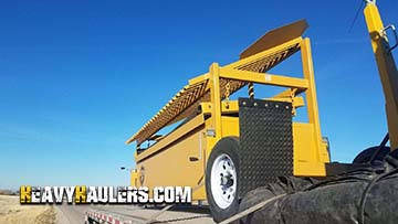 Transporting a mobile screener on a flatbed trailer