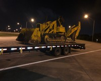 oversize construction equipment on a flatbed