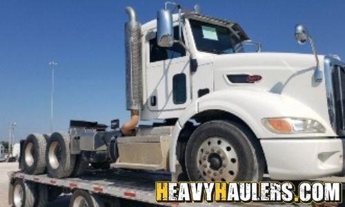 2013 peterbilt 384 Daycab loaded on a stepdeck trailer