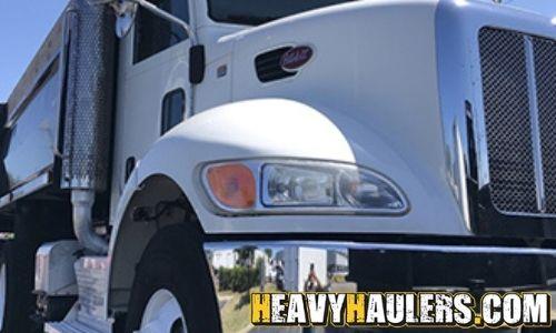 Peterbilt 348 dump truck hauled on a hotshot trailer