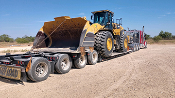 Caterpillar 982M Wheel Loader shipped on an RGN trailer