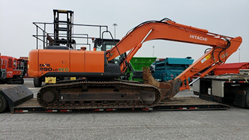 Hitachi ZX290 excavator being shipped on an RGN trailer