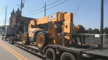 JCB telehandler shipped on an RGN trailer