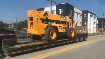 JCB telehandler hauled on an RGN trailer