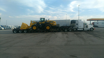 Komatsu wheel loader shipped on an rgn trailer