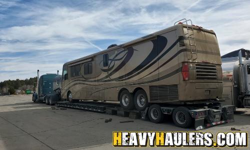 Class A RV transport on a drop deck trailer.
