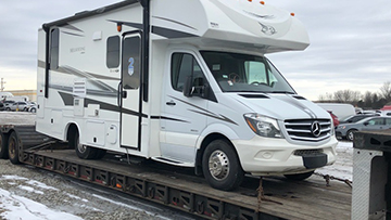Tear drop RV being hauled on a trailer