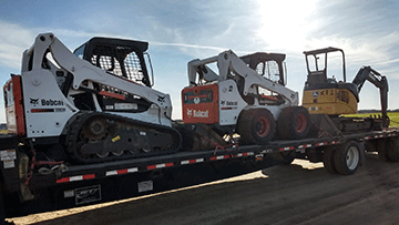 Hauling a Bobcat S750 Skid Steer and Bobcat T590 Track Loader