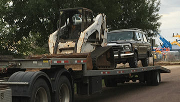 Skid Steer transport in Washington