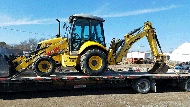New Holland Backhoe being Transported