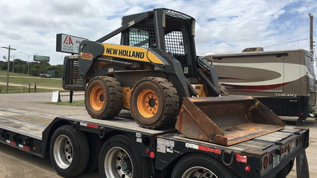 New Holland Skid Steer being Transported