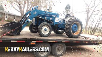 Hauling a 1971 Ford tractor on a hotshot trailer services