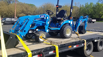 Shipping a 2018 LS MT 125 tractor on a hotshot trailer services