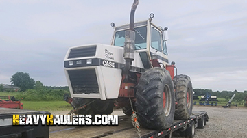 Hauling a Case 4690 tractor on a hotshot trailer services