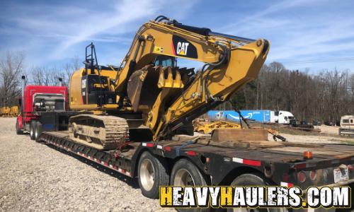 excavator transported on a step deck trailer