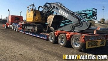 Removable Goose Neck (RGN) Trailer Shipping an Excavator