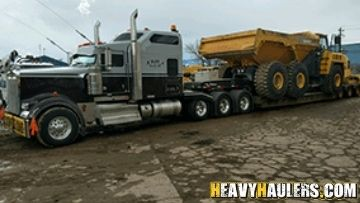 Removable Goose Neck (RGN) Trailer Shipping a Dump Truck