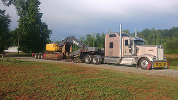 John Deere 270 transported on a RGN trailer
